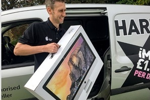 Man delivers Apple Desktop